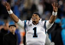 Carolina Panthers quarterback Cam Newton celebrates on the side lines during the fourth quarter against the Arizona Cardinals in the NFC Championship football game in Charlotte, North Carolina, in this file photo taken January 24, 2016.  Jeremy Brevard-USA TODAY Sports/Files