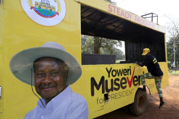 A woman gets off a truck with pictures of National Resistance Movement (NRM) party candidate Yoweri Museveni in Masindi town January 23, 2016 ahead of the February 18 presidential election. REUTERS/James Akena