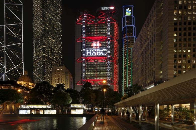 The HSBC headquarters is lit up at the Central Financial District in Hong Kong November 3, 2015. REUTERS/Bobby Yip