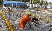 A technician works inside the Oil and Natural Gas Corp (ONGC) group gathering station on the outskirts of the western Indian city of Ahmedabad March 2, 2012. REUTERS/AMIT DAVE