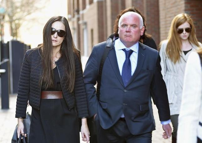 Lorraine Drumm, wife of former Anglo Irish Bank CEO David Drumm, walks with her brother-in-law Kenneth Drumm after leaving a federal courtroom in Boston, Massachusetts November 13, 2015. REUTERS/Faith Ninivaggi