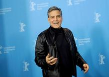 Actor George Clooney poses during a photocall to promote the movie 'Hail, Caesar!' at the 66th Berlinale International Film Festival in Berlin, Germany February 11, 2016.      REUTERS/Stefanie Loos