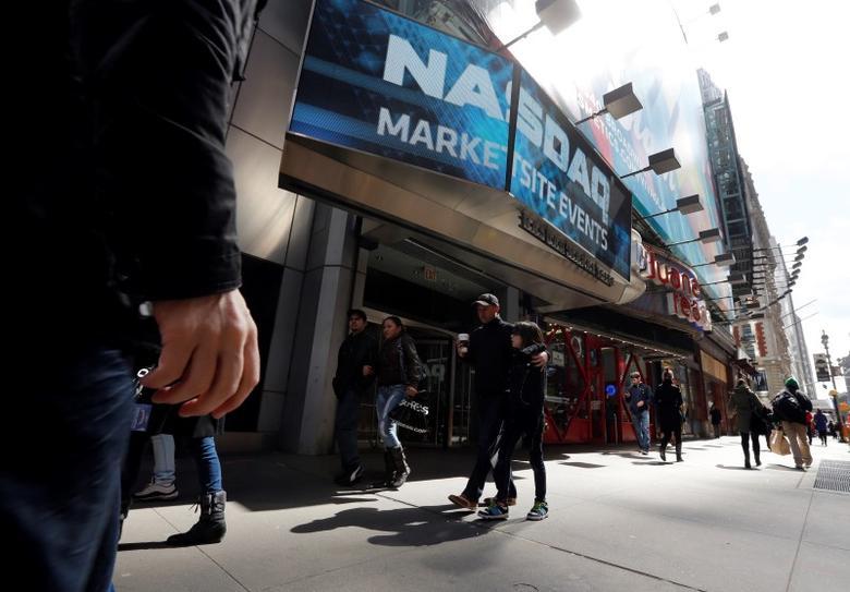 The Nasdaq logo is seen on the exterior screen at the Nasdaq MarketSite in New York, April 2, 2013.  REUTERS/Brendan McDermid