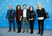 Cast members Rym Ben Messaoud, Sabah Bouzouita (2nd R) Majd Mastoura (L) director Mohamed Ben Attia (C) and producer Dora Bouchoucha Fourati (R) pose during a photocall to promote the movie 'Inhebbek Hedi' at the 66th Berlinale International Film Festival in Berlin February 12, 2016.     REUTERS/Fabrizio Bensch