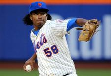New York Mets Jenrry Mejia delivers a pitch during the first inning against the Miami Marlins at Citi Field in New York, in this file photo taken April 26, 2014. Mandatory Credit: Anthony Gruppuso-USA TODAY Sports/Files