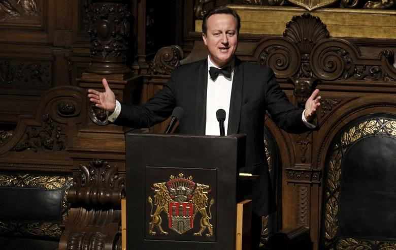 Britain's Prime Minister David Cameron speaks during the traditional historic banquet ''Matthiae-Mahlzeit'' (St. Matthew's Day Banquet) at the town hall in Hamburg February 12, 2016. The citizens of Hamburg have been celebrating the world's oldest banquet with their guests since 1356. REUTERS/Morris Mac Matzen - RTX26PQD