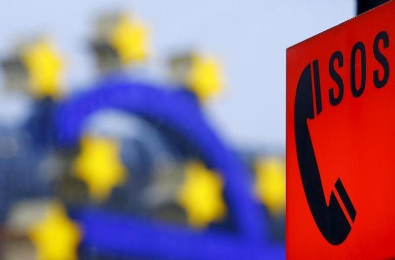 An emergency phone is seen near the famous euro sign landmark outside the former headquarters of the European Central Bank in Frankfurt, Germany, January 19, 2016. REUTERS/Kai Pfaffenbach