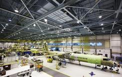 Bombardier q400 airplanes are seen being assembled at the Bombardier aircraft manufacturing facility in Toronto, in this November 25, 2010 file photo. REUTERS/Mark Blinch