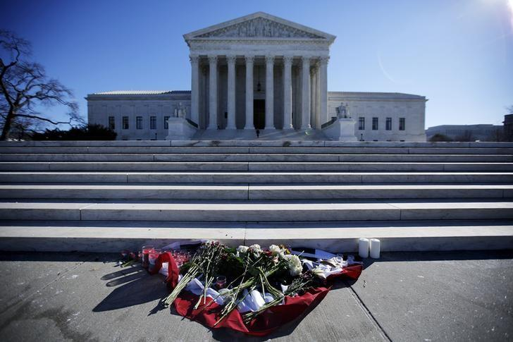 Flowers are seen in front of the Supreme Court building in Washington D.C. after the death of U.S. Supreme Court Justice Antonin Scalia, February 14, 2016. REUTERS/Carlos Barria . SAP is the sponsor of this content. It was independently created by Reuters' editorial staff and funded in part by SAP, which otherwise has no role in this coverage.