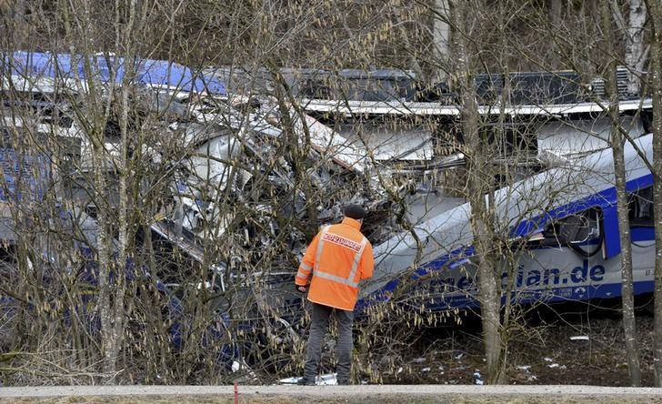 A rescuer stands at the site of the crash of two trains near Bad Aibling in southwestern Germany, February 10, 2016.  REUTERS/Lukas Barth