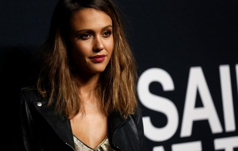 Actress Jessica Alba poses as she arrives for the Saint Laurent fall collection fashion show at the Hollywood Palladium in Los Angeles, California February 10, 2016.   REUTERS/Mario Anzuoni