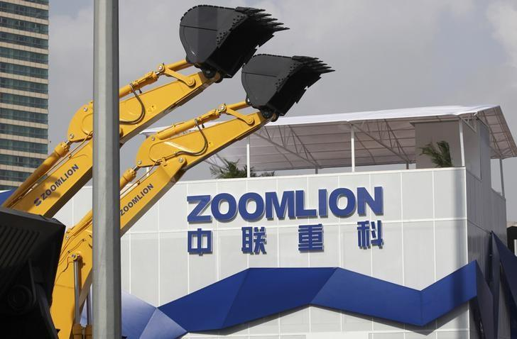 A Zoomlion company logo is seen next to its excavators at an exhibition in Shanghai, November 29, 2012.  REUTERS/Stringer