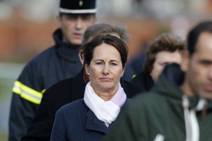 French Minister for Ecology, Sustainable Development and Energy Segolene Royal arrives at the scene near the wreckage of a school minibus after it crashed into a metal panel which fell from a truck in Rochefort, France, February 11, 2016.  REUTERS/Regis Duvignau