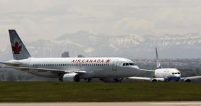 An Air Canada plane lands in front of a United plane at the Calgary International Airport in Calgary, Alberta, in this file photo dated June 17, 2008. REUTERS/Todd Korol