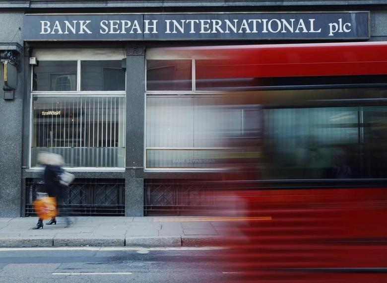 A red London bus passes a branch of Iranian owned Bank Sepah International in London December 22, 2011.  REUTERS/Luke MacGregor