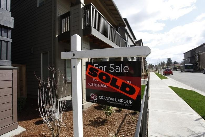 Sold homes are seen in the southwest area of Portland, Oregon in this March 20, 2014 file photo. REUTERS/Steve Dipaola