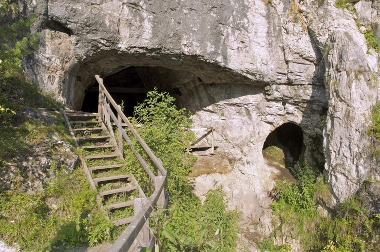 The entrance to Denisova Cave in the Altai Mountains in southern Siberia near the Russia-Mongolia border where the remains of a female Neanderthal were found is shown in this 2011 photo released on February 17, 2016. A new study has found that her genome contained DNA from Homo sapiens, indicating that our species had interbred with Neanderthals about 100,000 years ago.  REUTERS/Bence Viola/Max-Planck-Institute of Evolutionary Anthropology/Handout via Reuters