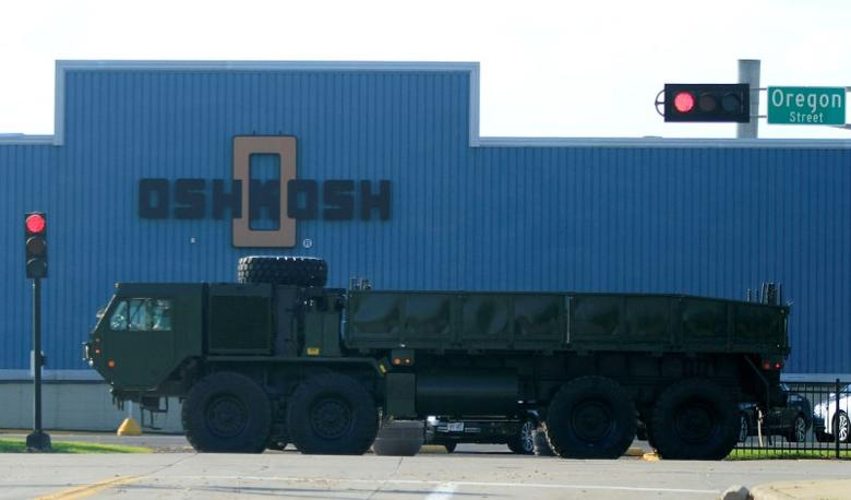 A military vehicle passes by the Oshkosh plant in Wisconsin October 12, 2011. REUTERS/Darren Hauck
