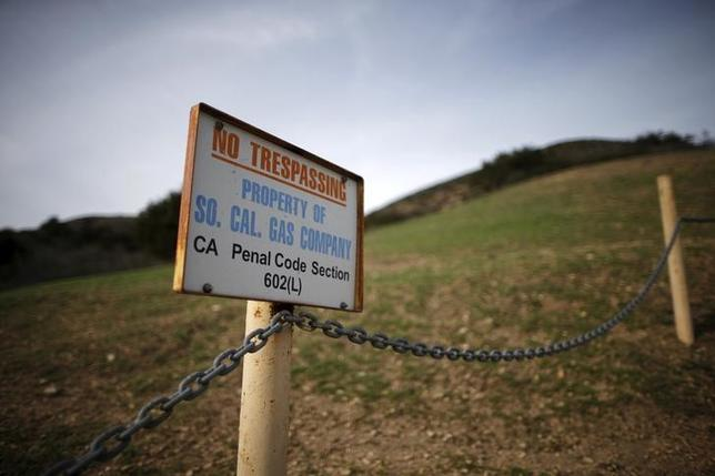 A gas company sign marks a fence near the site of the Aliso Canyon storage field where gas has been leaking in Porter Ranch, California, United States, January 21, 2016.    REUTERS/Lucy Nicholson