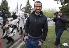 Omar Khadr leaves a news conference after being released on bail in Edmonton, Alberta, May 7, 2015. REUTERS/Todd Korol