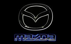The Mazda logo is shown as the new Mazda CX-9 is introduced during the Los Angeles Auto Show in Los Angeles, California November 18, 2015. REUTERS/Mike Blake