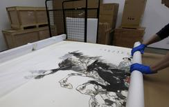 Part of a Chinese painting is shown at a warehouse rented by Hong Kong Takung Assets and Equity of Artworks Exchange Co. Ltd. in Hong Kong, China February 18, 2016.   REUTERS/Bobby Yip