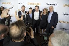 "Boston Globe journalists, upon whom the movie is based, Ben Bradlee Jr. (L) Mike Rezendes , Sacha Pfeiffer (2nd R) and Walter ""Robby"" Robinson (R) pose with director Thomas McCarthy (C) during the special screening of ""Spotlight"" at the DGA Theater in Los Angeles, California November 3, 2015.  REUTERS/David McNew"