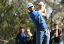 February 19, 2016; Pacific Palisades, CA, USA; Dustin Johnson hits from the fourth hole tee during the second round of the Northern Trust Open golf tournament at Riviera Country Club. Mandatory Credit: Gary A. Vasquez-USA TODAY Sports