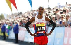 Athletics - Great North Run - Newcastle, Gateshead & South Shields - 13/9/15 Great Britain's Mo Farah after he wins the Men's Great North Run ahead of Kenyan's Stanley Biwott   Action Images via Reuters / Craig Brough Livepic