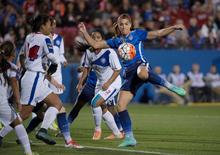 Feb 15, 2016; Frisco, TX, USA; United States forward Alex Morgan (13) kicks the ball in the Puerto Rico zone during the second half at Toyota Stadium. The United States shuts out Puerto Rico 10-0. Mandatory Credit: Jerome Miron-USA TODAY Sports
