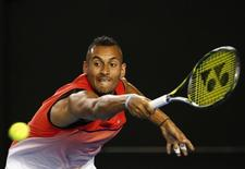 Australia's Nick Kyrgios stretches to hit a shot during his third round match against Czech Republic's Tomas Berdych at the Australian Open tennis tournament at Melbourne Park, Australia, January 22, 2016. REUTERS/Thomas Peter