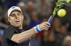 Sam Querrey of the U.S. returns a shot to Argentina's Juan Martin del Potro after Querrey won their men's semi-final match at the Delray Beach Open tennis tournament in Delray Beach, Florida February 20, 2016. REUTERS/Andrew Innerarity