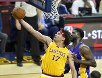 Feb 10, 2016; Cleveland, OH, USA; Cleveland Cavaliers forward Anderson Varejao (17) rebounds beside Los Angeles Lakers center Roy Hibbert (17) in the third quarter at Quicken Loans Arena. Mandatory Credit: David Richard-USA TODAY Sports