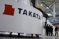 Visitors walk behind a logo of Takata Corp on its display at a showroom for vehicles in Tokyo, Japan, November 6, 2015. REUTERS/Toru Hanai