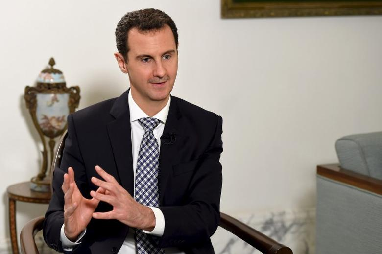 Syria's President Bashar al-Assad speaks during an interview with Spanish newspaper El Pais in Damascus, in this handout picture provided by SANA on February 20, 2016.  REUTERS/SANA/Handout via Reuters