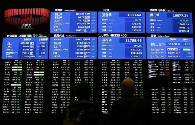 Visitors looks at an electronic board showing the Japan's Nikkei average (top R) at the Tokyo Stock Exchange (TSE) in Tokyo, Japan, February 9, 2016. REUTERS/Issei Kato