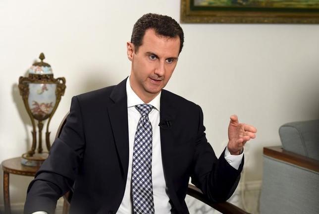 2月23日、シリア政府は、「戦闘作戦」の中止で合意したと明らかにした。米国とロシアが合意したシリア内戦の一時停戦条件に沿ったもの。写真はシリアのアサド大統領、ダマスカスで20日撮影(2016年 ロイター/SANA)