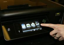 "A touch screen menu is displayed on a Lexmark Platinum Pro905 printer during ""CES Unveiled,"" a media preview event, at the 2010 International Consumer Electronics Show (CES) in Las Vegas, Nevada in this file photo dated January 5, 2010. REUTERS/Steve Marcus"