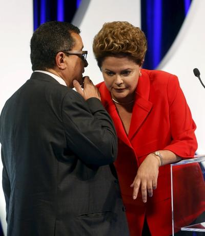 Brazilian presidential candidate Dilma Rousseff (R) of the Workers Party (PT) talks with Joao Santana, head of the electoral accompaniment, before she takes part in a television debate in Sao Paulo, Brazil, in this September 1, 2014 file photo. REUTERS/Paulo Whitaker/Files