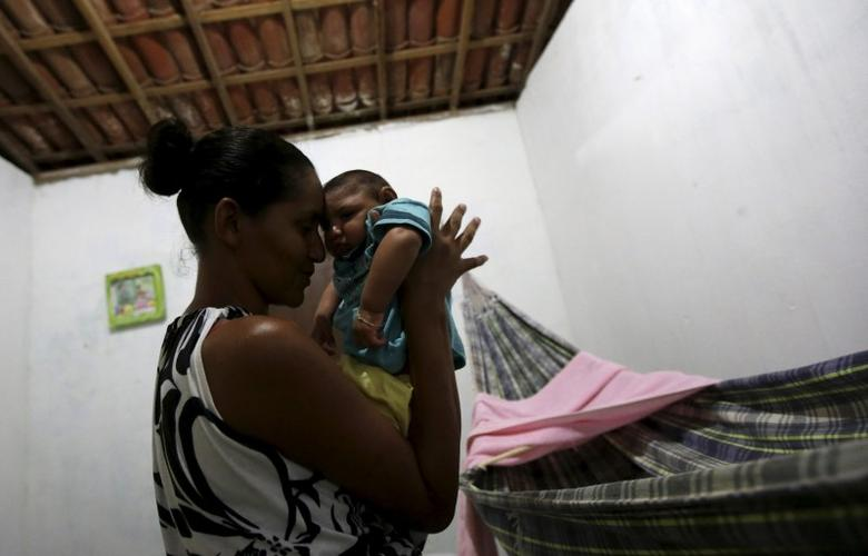 Miriam Araujo, 25, holds Lucas, her 4-months old child born with microcephaly at their house, in Sao Jose dos Cordeiros, Brazil February 16, 2016.  REUTERS/Ricardo Moraes