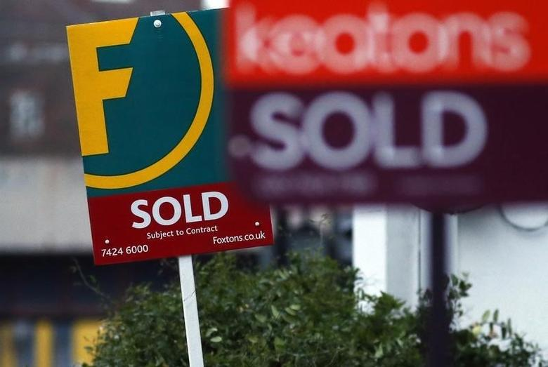 Estate agent signs are displayed outside residential properties in London, Britain January 23, 2016.   REUTERS/Neil Hall