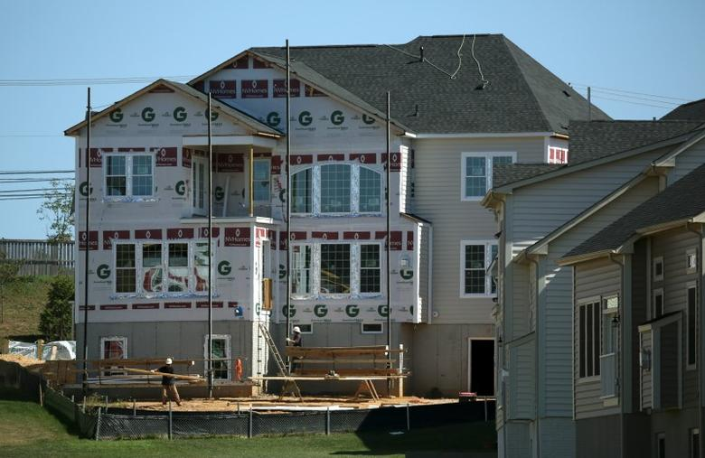 Workers install siding on a home at a large subdivision in Damascus, Maryland September 15, 2015. REUTERS/Gary Cameron