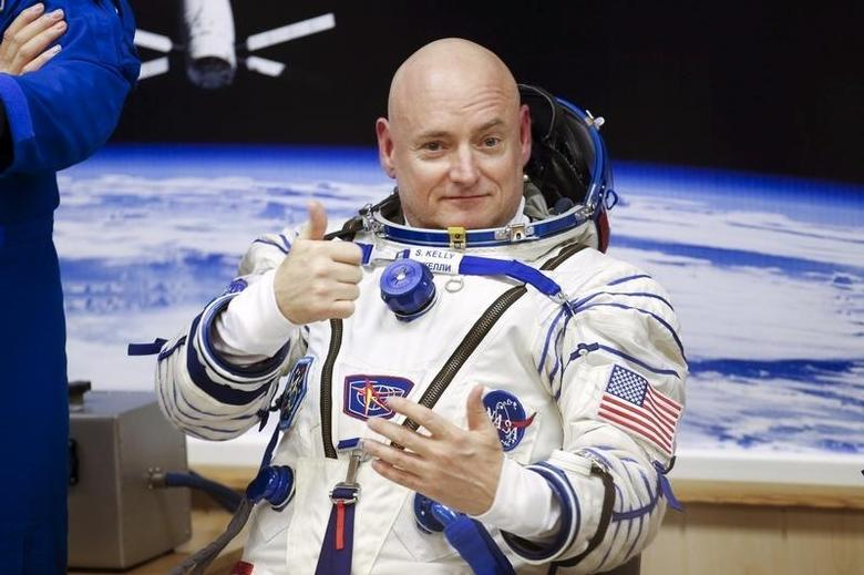 NASA astronaut Scott Kelly gestures during a space suit check at the Baikonur cosmodrome March 27, 2015.   REUTERS/Maxim Zmeyev