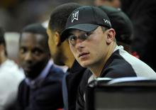 Cleveland Browns quarterback Johnny Manziel watches a Cleveland Cavaliers and Dallas Mavericks basketball game in Cleveland, Ohio, in this file photo taken October 17, 2014.  Mandatory Credit: David Richard-USA TODAY Sports/Files