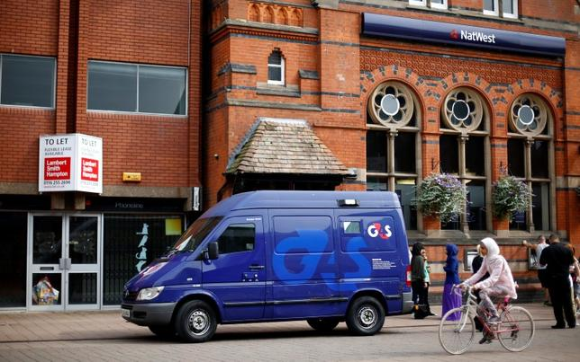 File photo of a G4S security van parked outside a bank in Loughborough, central England, August 28, 2013.     REUTERS/Darren Staples