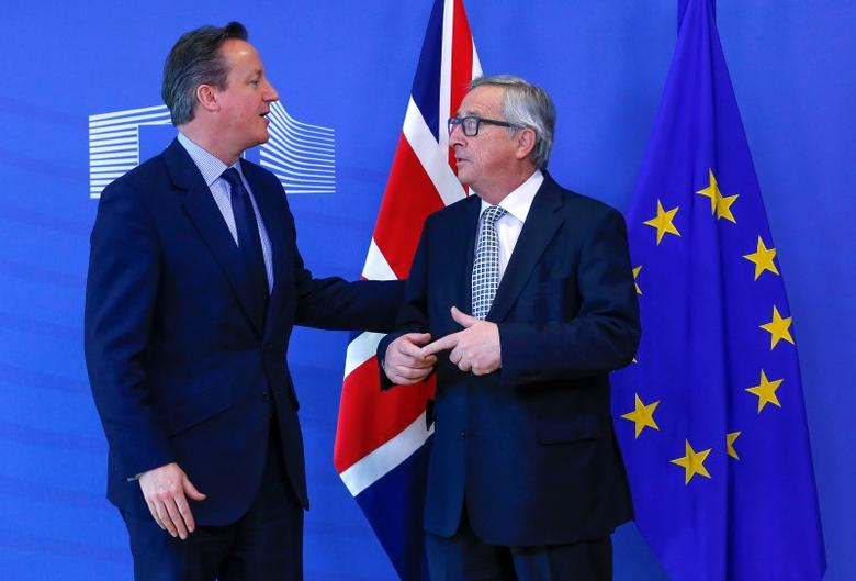 Britain's Prime Minister David Cameron (L) is welcomed by European Commission President Jean-Claude Juncker (R) ahead of a meeting at the EU Commission headquarters in Brussels, Belgium February 16, 2016.  REUTERS/Yves Herman