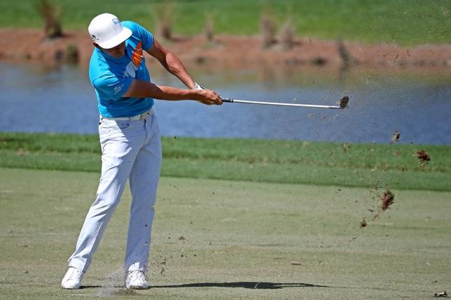 Feb 26, 2016; Palm Beach Gardens, FL, USA; Rickie Fowler plays from the 9th fairway during the second round of the Honda Classic at PGA National. Mandatory Credit: Peter Casey-USA TODAY Sports