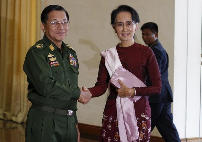 Senior General Min Aung Hlaing (L), Myanmar's commander-in-chief, shakes hands with National League for Democracy (NLD) party leader Aung San Suu Kyi before their meeting in Hlaing's office at Naypyitaw December 2, 2015. REUTERS/Soe Zeya Tun