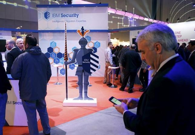 Attendees gather next to the exhibit stall of IBM Security at the Cybertech 2016 conference in Tel Aviv, Israel January 26, 2016. REUTERS/Baz Ratner