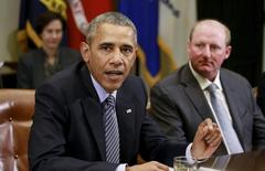 Berkshire Hathaway Energy CEO Gregory Abel (R) is seated next to U.S. President Barack Obama (L), who was hosting a roundtable with CEOs to discuss efforts to tackle climate change both in the United States as well as on a global scale at the White House in Washington October 19, 2015. REUTERS/Kevin Lamarque